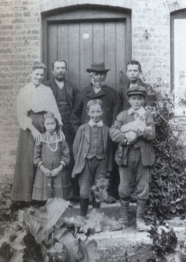 Thomas (centre, back), William (left, back) and Eddie (right, back)
