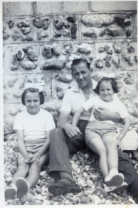 Annie (left) with her sister and father, James.