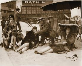 Ladies lounging in the sand wearing their fur coats at Club Casa del Mar circa 1920.